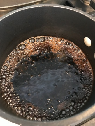 Early simmer. Bubbles are smaller and around the outside of the pan.